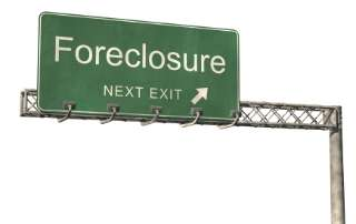 "Large fictitious overhead green freeway sign saying ""Foreclosure Next Exit"""