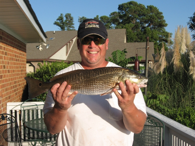 Realtor Gary Poindexter holding Red Drum caught on the Neuse River