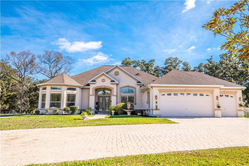 Photo of home for sale at 7050 QUARTERHORSE LANE, Brooksville FL