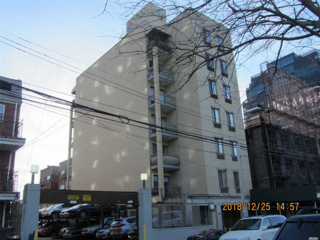 Photo of home for sale at 146-14 35 Ave, Flushing NY