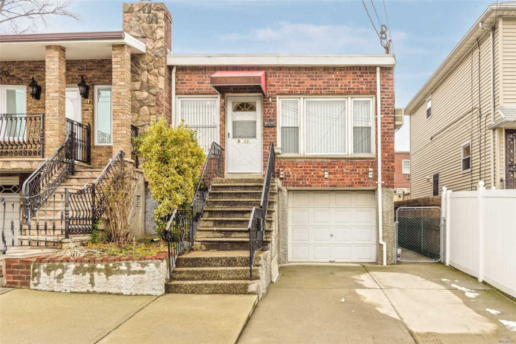 Photo of home for sale at 9-11 127th St, College Point NY