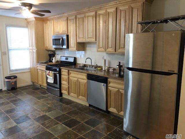 Photo of home for sale at 57-20 69th Ln, Maspeth NY