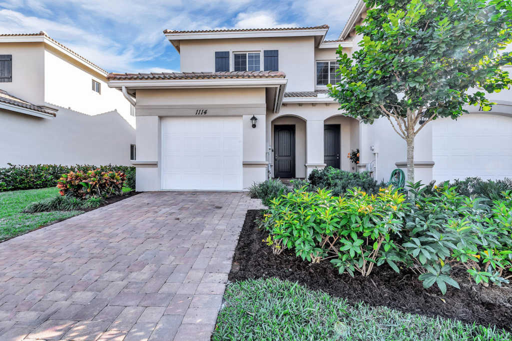 Photo of home for sale at 1114 Vermilion Drive, Lake Worth FL