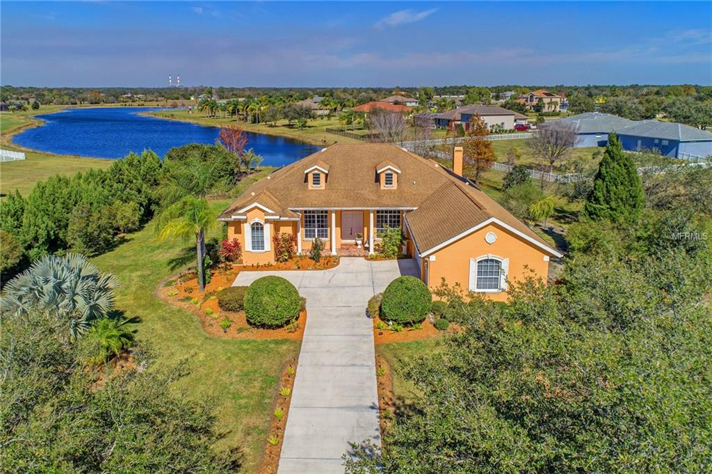 Photo of home for sale at 17814 HOWLING WOLF RUN, Parrish FL