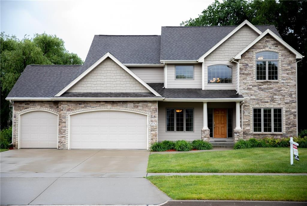 Photo of home for sale at 14512 Hickory Drive, Urbandale IA