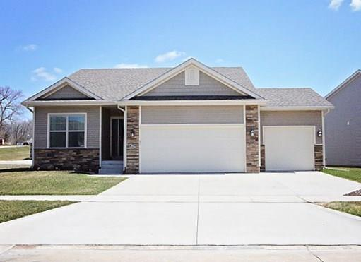 Photo of home for sale at 829 Wolf Creek Drive, Polk City IA
