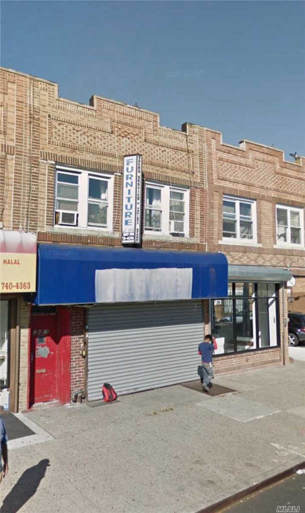 Photo of home for sale at 204-19 Jamaica Ave, Hollis NY