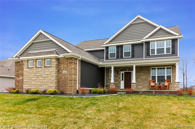 Photo of home for sale at 2200 Walnut View Drive, Hartland Township MI