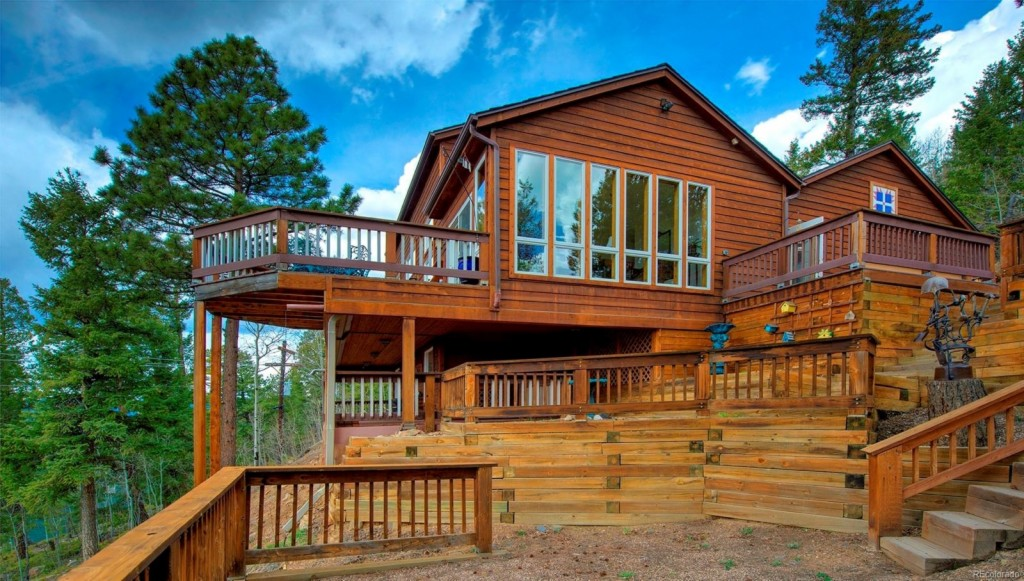Photo of home for sale at 11711 Baca Road, Conifer CO