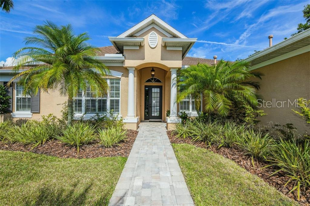 Photo of home for sale at 8307 PLANTERS KNOLL TERRACE, University Park FL
