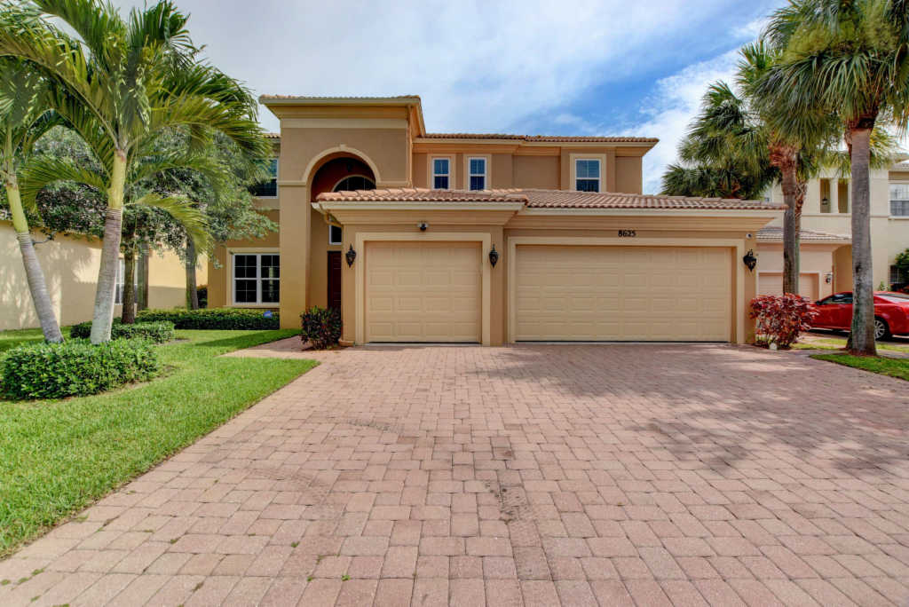 Photo of home for sale at 8625 Palisades Lakes Drive, West Palm Beach FL