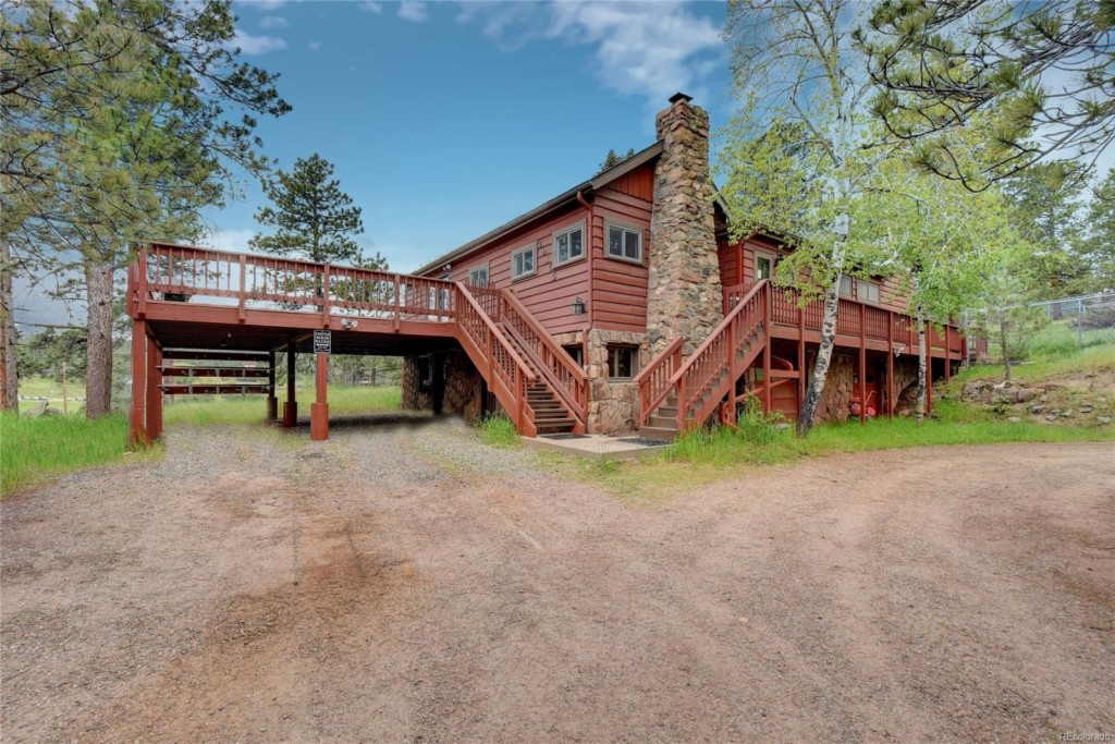 Photo of home for sale at 29155 Pine Road, Evergreen CO