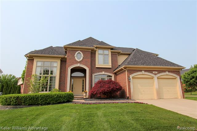 Photo of home for sale at 24477 Thatcher Drive, Novi MI