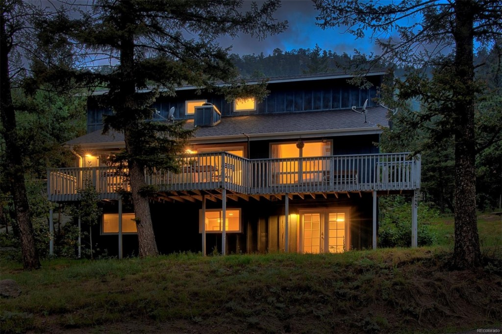 Photo of home for sale at 12085 Bear Park Road, Conifer CO