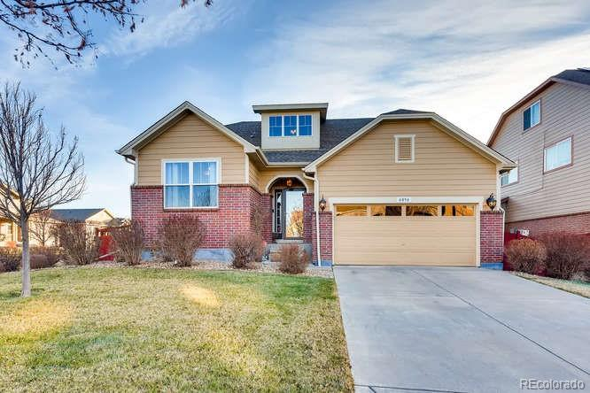Photo of home for sale at 6094 Ensenada Court N, Aurora CO