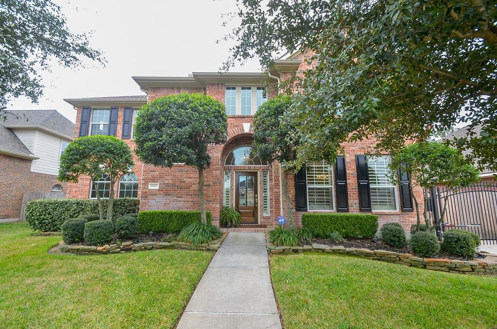 Photo of home for sale at 11423 Kingsbarn Court, Tomball TX