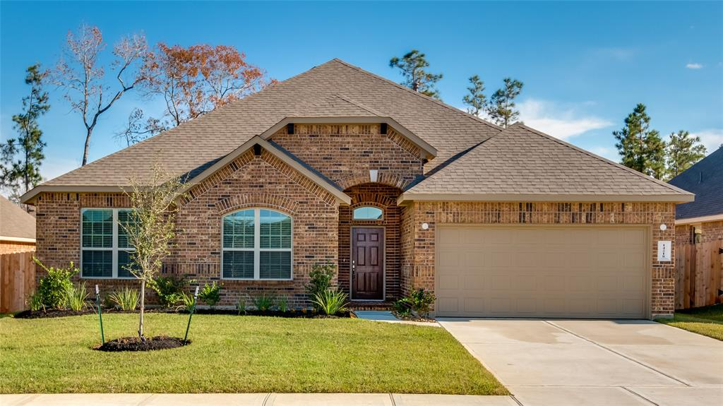 Photo of home for sale at 14218 Rainier Peak Crossing, Conroe TX