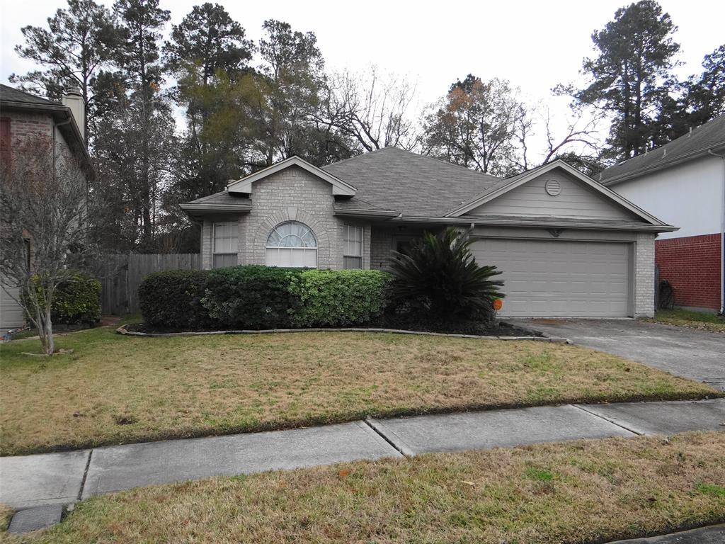 Photo of home for sale at 21823 Whispering Forest Drive, Kingwood TX