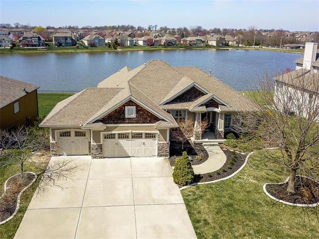 Photo of home for sale at 204 Waterwheel Lane SE, Lee's Summit MO
