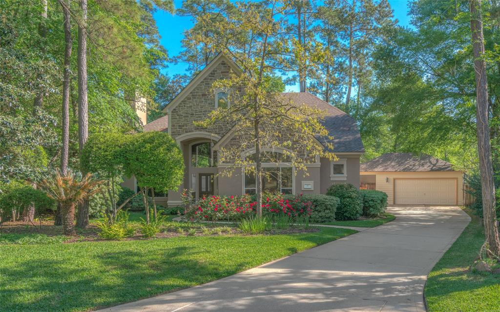 Photo of home for sale at 30 Heather Wisp Place, Spring TX