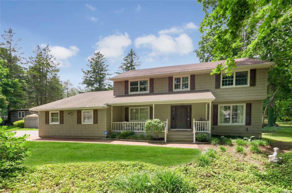 Photo of home for sale at 11 Village Woods Rd, Port Jefferson NY