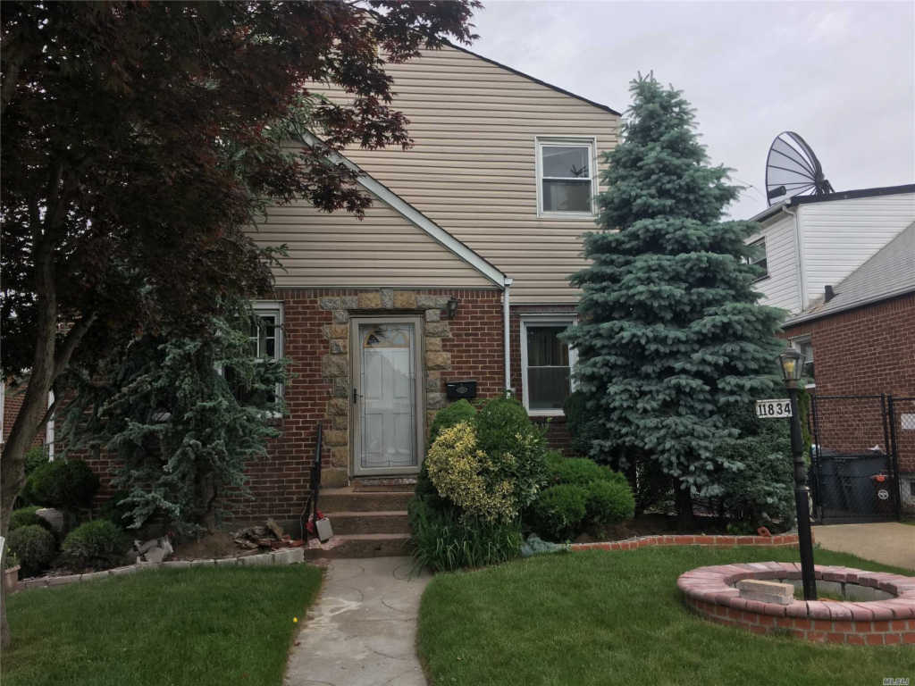 Photo of home for sale at 118-34 228th St, Cambria Heights NY