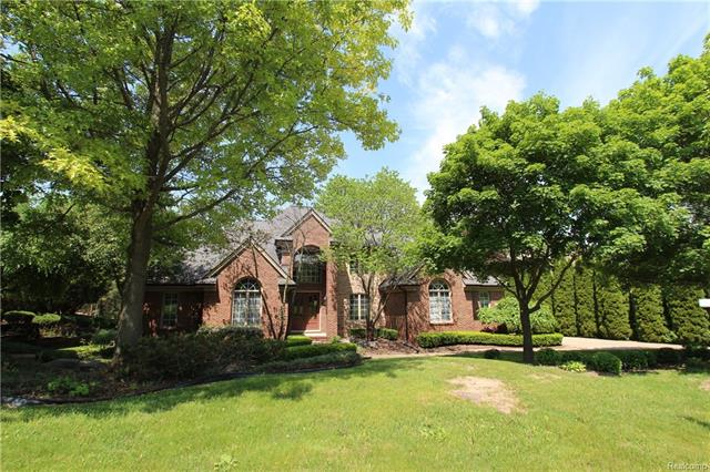 Photo of home for sale at 17385 Rolling Woods Circle, Northville Township MI