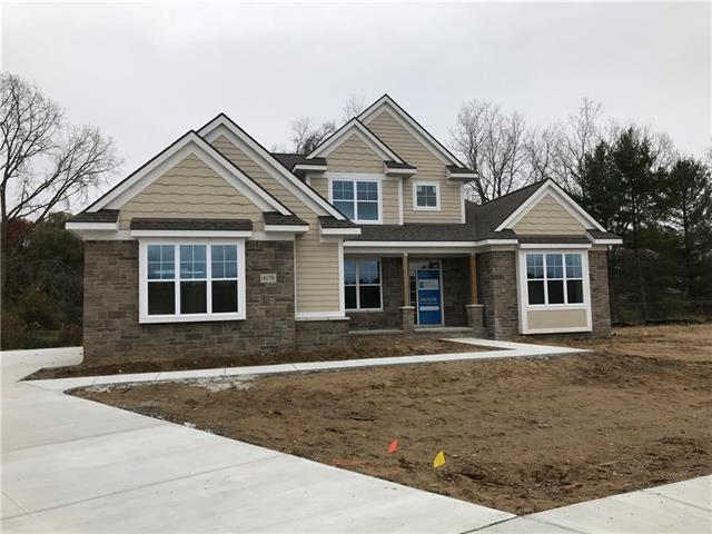 Photo of home for sale at 4106 Ascott Lane, Commerce Township MI