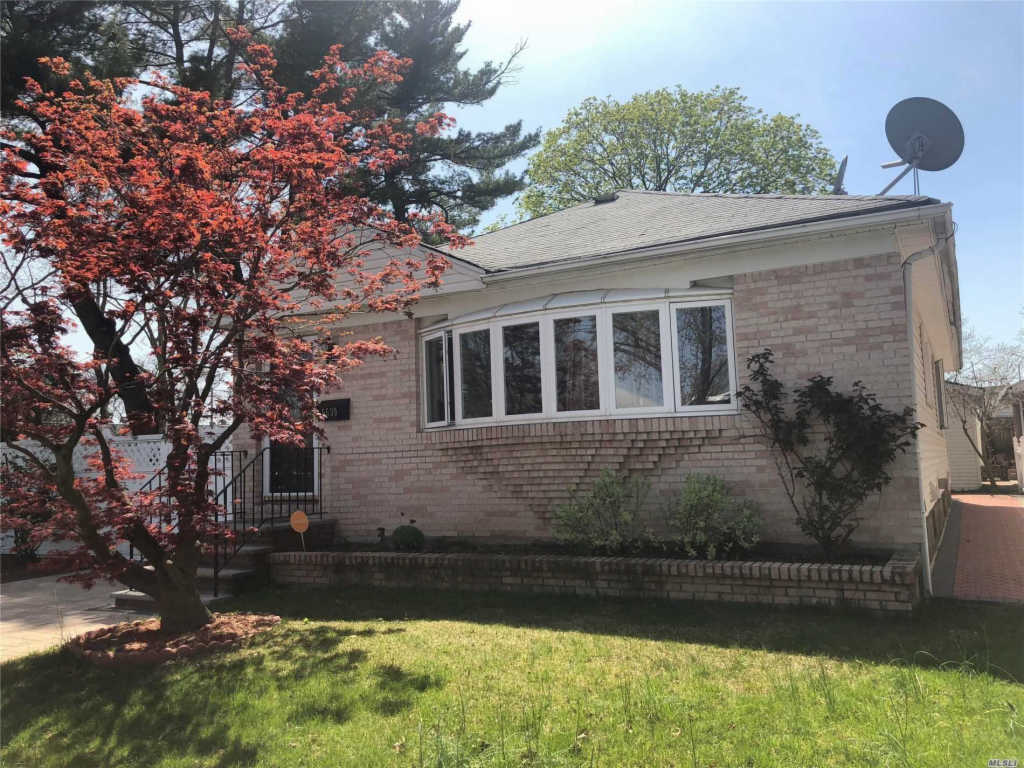 Photo of home for sale at 56-30 229 St, Bayside NY