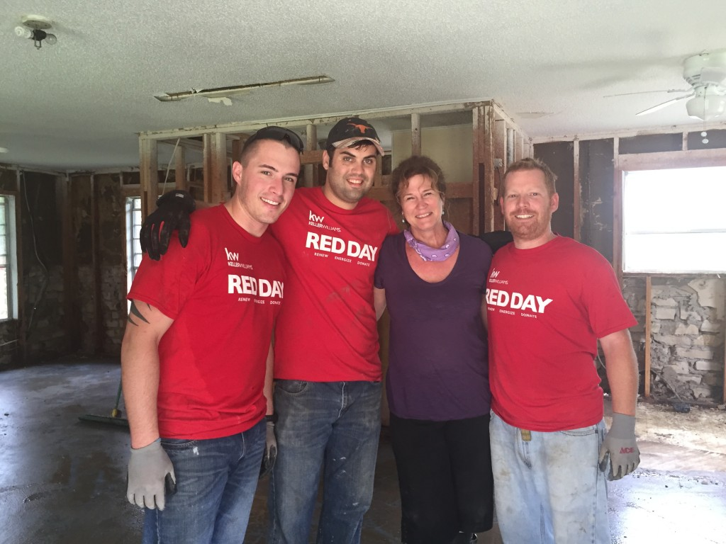 Keller Williams associates assist a homeowner in Wimberley, Tex.