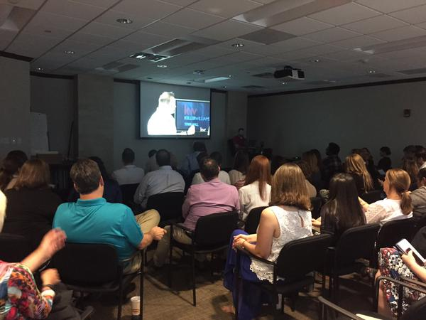 A group of agents watching the live streaming KW Town Hall co-hosted by CEO Chris Heller and President John Davis.